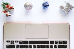 Computer Laptop for working with Christmas and New Year ornaments and decoration. On white background Royalty Free Stock Images