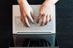 Computer laptop working concept. Hands typing keyboard royalty free stock photography