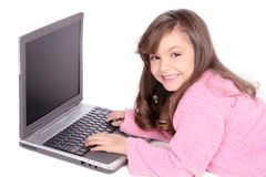 Computer laptop and young girl Royalty Free Stock Image