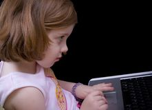 Computer learning. Little girl playing educational computer games Stock Images