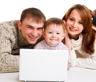 Computer life. Mother, father and little boy with laptop- computer life Stock Image