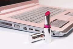 Computer and lipstick Royalty Free Stock Photos