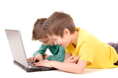 Computer. Little kids with computer isolated in white background Royalty Free Stock Images