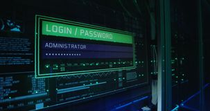 Computer login screen in a modern data center. Close up shot of a computer login screen in a modern data center then appear message ddos attack stock video footage