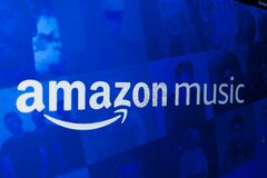 Computer with the logo of AMAZON MUSIC, online music service.