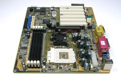 Computer Main Board. OLYMPUS DIGITAL CAMERA Full shot of Computer Motherboard stock image
