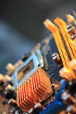 Computer Mainboard. A closeup view of a computer mainboard heatsink. Computing concept. Vertical Royalty Free Stock Photography