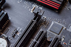 Computer mainboard. Electronic printed circuit board chemicon Royalty Free Stock Image