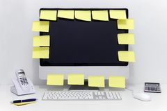 Computer with many empty adhesive notes Stock Photo