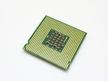 Computer micro processor. The computer the processor on a white background is isolated gold color with a microcircuit Royalty Free Stock Photography