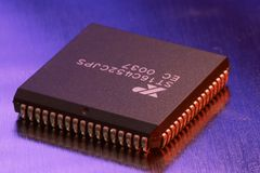 Computer microchip. Computer chip on an iron palte stock images