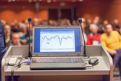 Computer and microphone on rostrum at business event. stock images