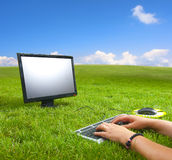 Computer in the middle of the meadow Royalty Free Stock Images