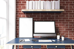 Computer monitor against brick wall Stock Photos