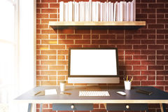 Computer monitor against brick wall, toned Stock Photography