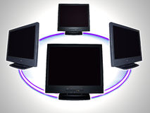 Computer monitor - computer network. Concept photo of flat screen computer monitors isolated over white by clipping path depicting a network stock photography