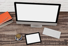 Computer monitor and digital tablet on desk royalty free stock image