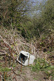 Computer monitor dumped in countryside. Computer monitor illegally dumped in countryside, fly tipping stock photo