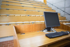 Computer monitor with empty seats in a lecture hall Stock Image