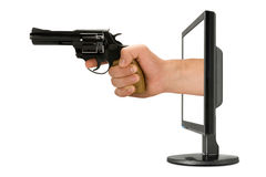 Computer monitor and hand with gun Royalty Free Stock Photos