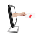 Computer monitor and hand with letter Royalty Free Stock Image
