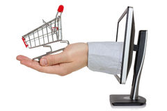 Computer monitor and hand with shopping cart Stock Image