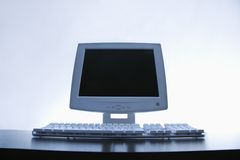 Computer monitor and keyboard. Royalty Free Stock Photo