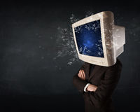 Computer monitor screen exploding on a young persons head Stock Photos