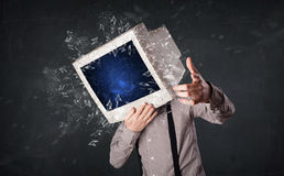 Computer monitor screen exploding on a young persons head Royalty Free Stock Photography