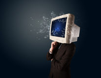 Computer monitor screen exploding on a young persons head Royalty Free Stock Image