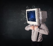 Computer monitor screen exploding on a young persons head Royalty Free Stock Images