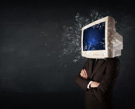 Computer monitor screen exploding on a young persons head Royalty Free Stock Photo