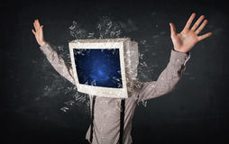 Computer monitor screen exploding on a young persons head. Concept Royalty Free Stock Image