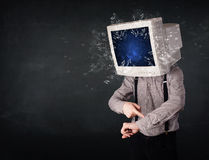 Computer monitor screen exploding on a young persons head Royalty Free Stock Photos