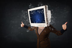 Computer monitor screen exploding on a young persons head Stock Image