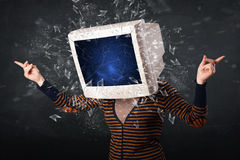 Computer monitor screen exploding on a young persons head Stock Photography