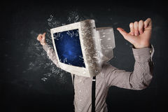 Computer monitor screen exploding on a young persons head Stock Photo