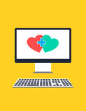 Computer monitor with two hearts depicting online dating concept Stock Images