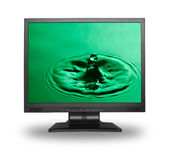 Computer monitor with water splash Royalty Free Stock Photos
