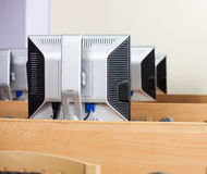 Computer Monitors Arranged In Row At Classroom Royalty Free Stock Images