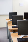 Computer Monitors With Blank Screens In Classroom Stock Image