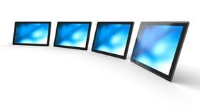 Computer monitors or screens. Four computer monitors or display screens Royalty Free Stock Image