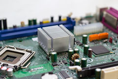 Computer motherboard. Closeup of computer motherboard isolated against white background Stock Photography