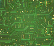 Computer motherboard background. Macro on illustrated green motherboard with circuits Stock Image
