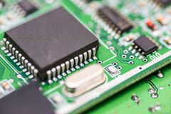 Computer motherboard. Chip close up on a integrated circuit. Electronic circuit board close up. Tech science background. royalty free stock image