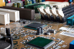 Computer motherboard with chips, memory slots, pci Royalty Free Stock Images