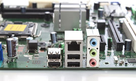 A computer motherboard closeup view of connections. A studio captured image of a computer motherboard connections on white background royalty free stock images