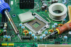 Computer motherboard and equipment repair. Stock Image
