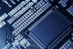Computer motherboard with microchip. Closeup Royalty Free Stock Photos