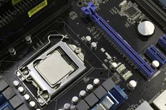 Computer motherboard, with processor installed on it stock images